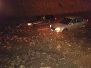Two cars became stuck in a mudslide along Pacific Coast Highway in Malibu on Jan. 5, 2019. (Credit: Caltrans)