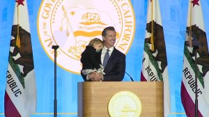 California Gov. Gavin Newsom is joined on stage by his 2-year-old son Dutch at his inaugural address on Jan. 7, 2019. (Credit: KTXL)
