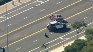 An LAPD cruiser attempts a PIT maneuver on a pursuit suspect on the Westside on Jan. 3, 2019. (Credit: KTLA)