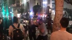 A still from video taken on Jan. 26, 2019 shows a man, later identified as Arka Oroojian, punching one of two women in downtown Los Angeles. (Credit: Mike Watson via Facebook)