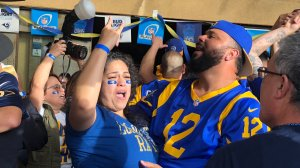 Los Angeles Rams fans at Big Wangs in North Hollywood celebrate the team's victory over the New Orleans Saints in the NFC championship game to advance to the Super Bowl on Jan. 20, 2019.