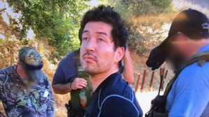Anthony Rauda is seen being taken into custody in a remote area of Malibu Creek State Park on Oct. 10, 2018, in an image released by the Los Angeles County Sheriff's Department.
