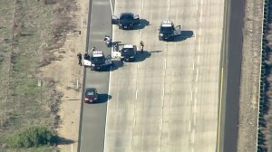 A driver leading authorities on a multicounty pursuit stops on the 5 Freeway in Camp Pendleton on Jan. 3, 2019. (Credit: KTLA)