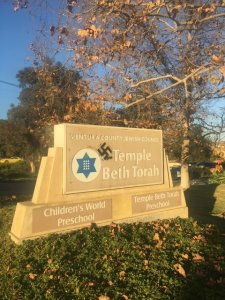 A swastika is seen spray-paint on a sign at the Temple Beth Torah in a photo provided by Ventura police on Jan. 4, 2019.
