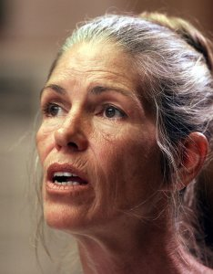 Leslie Van Houten, a former follower of Charles Manson, listens as former Deputy District Attorney Stephen Kay (not seen) describes the 1969 killing scene of the Smaldino couple during a parole hearing June 28, 2002, at the California Institution for Women in Corona. (Credit: DAMIAN DOVARGANES/AFP/Getty Images)