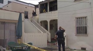 Officials investigate a fire that killed a 91-year-old man in the Pico-Robertson area on Feb. 26, 2019. (Credit: KTLA)