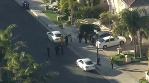 L.A. police and firefighters respond to a triple homicide in a gated community in Porter Ranch on Feb. 18, 2019. (Credit: KTLA)