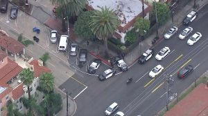 Several LAPD patrol cars are seen outside an apartment building at Franklin Avenue at North Gramercy Place after a lockdown a few blocks away at Sunset Bronson Studios on Feb. 14, 2018. (Credit: KTLA)