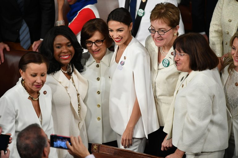 New York Representative (D) Alexandria Octavio-Cortez (center) poses for a picture with other women ahead of President Donald Trump's State of the Union address at the U.S. Capitol in Washington, D.C., on Feb 5, 2019. (Credit: MANDEL NGAN/AFP/Getty Images)