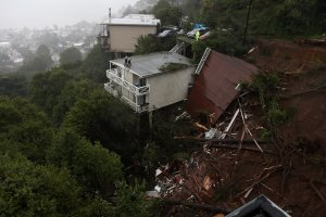 The roof of a home is seen after it was swept down a hill by a mudslide in Sausalito during a rain storm on Feb. 14, 2019. (Credit: Justin Sullivan / Getty Images)