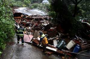 Southern Marin firefighters search a home that was swept down a hill by a mudslide in Sausalito during a rain storm on Feb. 14, 2019. (Credit: Justin Sullivan / Getty Images)