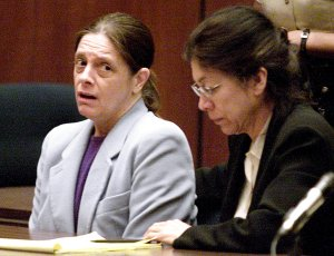 Marjorie Knoller listens, along with her attorney Nedra Ruiz, to the verdict being read in the dog mauling trial in Los Angeles on March 21, 2002. (Credit: LANCE IVERSEN/AFP/Getty Images)