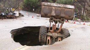 A front-loader fell into a hole on Yerba Buena Road on Feb. 2, 2019. (Credit: KTLA)