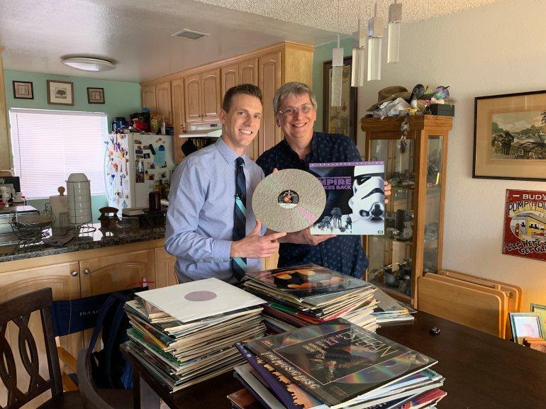Rich DeMuro and Jim Lawson hold a laserdisc