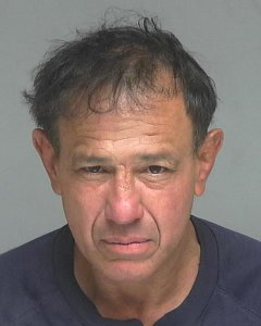 Jonny Knowles, 56, is seen in a booking photo released Feb. 6, 2019, by the Garden Grove Police Department.