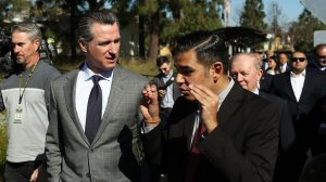 Gov. Gavin Newsom, center left, and Long Beach Mayor Robert Garcia, right, tour Century Villages at Cabrillo, an affordable housing development, on Feb. 19, 2019. (Credit: Dania Maxwell / Los Angeles Times)