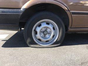 A tire that was slashed in Boyle Heights is seen on Feb. 11, 2019. (Credit: John Neis/KTLA)