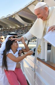 A little girl evaded tight police security inside Abu Dhabi's city stadium to run over and deliver a letter to Pope Francis on Feb. 6, 2019. (Credit: Vatican Media/REUTERS via CNN)