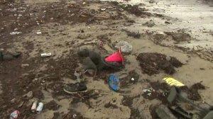 Trash is seen along Seal Beach on Feb. 5, 2019. (Credit: KTLA)