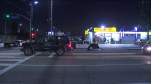 Police investigate the scene of a deadly shooting at Florence and Normandie avenues in South Los Angeles on Feb. 14, 2019. (Credit: KTLA)