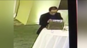 A suspect accused of stealing a box of cards containing cash is seen in surveillance footage at a wedding in Monrovia.