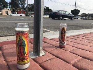 Mourners on March 27, 2019 left candles near the spot in Torrance where a 10-year-old boy was fatally struck by a pickup truck driver who swerved to avoid a dog. (Credit: KTLA)