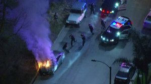 Police use a Taser to subdue a man following a pursuit that ended at Washington Boulevard and the 605 Freeway in Pico Rivera on March 15, 2019. (Credit: KTLA)