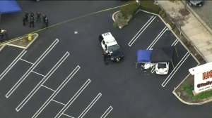 Police investigate the scene of a shooting that left a woman dead and a man wounded in the parking lot of a Big Lots store, 12550 Central Ave. in Chino, on March 21, 2019. (Credit: KTLA)