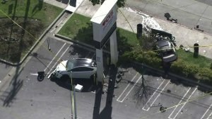 Two of three vehicles involved in a violent crash are shown on March 26, 2019. (Credit: KTLA)