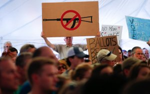 A man displays an anti gun violence sign during a March for our Lives Rally at Fairfield Hills Campus, in Newtown Connecticut on August 12, 2018. (Credit: KENA BETANCUR/AFP/Getty Images)