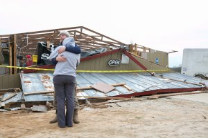 Gabe and Brandi O'Neal embrace outside of the Buck Wild Saloon after it was destroyed by a tornado on March 4, 2019, in Smith Station, Alabama.(Credit: Jessica McGowan/Getty Images)