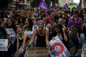 Women take part in a demonstration to mark International Women's Day in Mexico City on March 8, 2019. (Credit: Pedro Pardo / AFP / Getty Images)