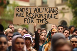 Protesters hold placards aloft as they march during the Stand Against Racism and Islamophobia: Fraser Anning Resign! rally on March 19, 2019, in Melbourne, Australia. (Credit: Scott Barbour/Getty Images)
