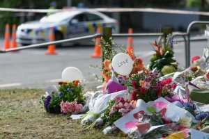 Flowers and condolences are seen in front of Al Noor mosque on March 20, 2019 in Christchurch, New Zealand. 50 people were killed, and dozens are still injured in hospital after a gunman opened fire on two Christchurch mosques on Friday, 15 March.  The accused attacker, 28-year-old Australian, Brenton Tarrant, has been charged with murder and remanded in custody until April 5. The attack is the worst mass shooting in New Zealand's history. (Credit: Kai Schwoerer/Getty Images)