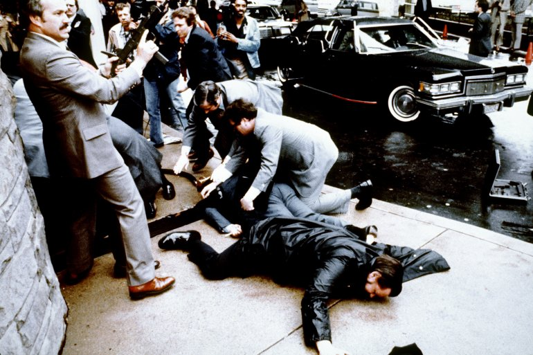 This photo taken by presidential photographer Mike Evens on March 30, 1981, shows police and Secret Service agents reacting during the assassination attempt on then-President Ronald Reagan outside the Hilton Hotel in Washington, D.C. (Credit: Mike Evens / AFP / Getty Images)