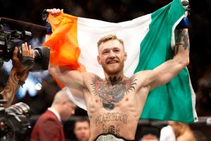 Conor McGregor celebrates after a first-round knockout victory over Jose Aldo in their featherweight title fight during UFC 194 on December 12, 2015 in Las Vegas, Nevada. (Credit: Steve Marcus/Getty Images)
