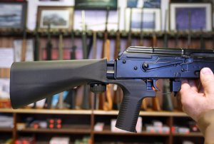 A bump stock device that fits on a semi-automatic rifle to increase the firing speed, making it similar to a fully automatic rifle, is installed on a AK-47 semi-automatic rifle at a gun store on October 5, 2017 in Salt Lake City, Utah. (Credit: George Frey/Getty Images)
