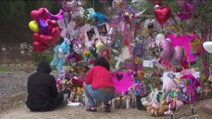 Mourners visit a memorial in Hacienda Heights on March 11, 2019, that was set up for a 9-year-old girl whose body was found in a suitcase on March 5, 2019. (Credit: KTLA)