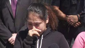 Liana Lopez, the sister of Steven Lopez, cries as she speaks to reporters on March 12, 2019. Steven was fatally shot in their Mid-City neighborhood nearly a year earlier on March 18, 2018. (Credit: KTLA)