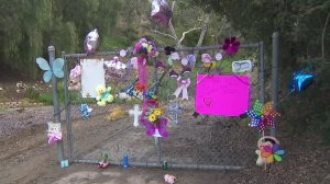 A memorial to an unidentified young girl found dead is seen on March 7, 2019, near where her body was discovered in Hacienda Heights two days before. (Credit: KTLA)