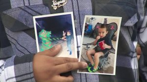 Oscar Ventura holds pictures of his son, Damien, taken two days before the boy died last July during a news conference announcing a lawsuit against Los Angeles County and its child services agency on March 1, 2019. (Credit: KTLA)