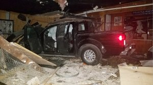 A pickup truck is seen inside the Party Doll bar in Highland on March 20, 2019. (Credit: KTLA)