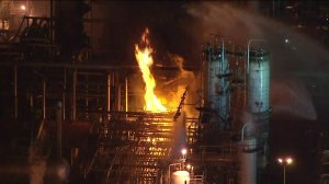 Firefighters battle flames at the Phillips 66 refinery in Carson on March 15, 2019. (Credit: KTLA)