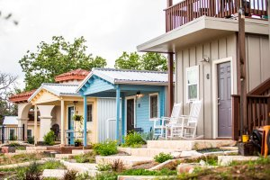 All the micro homes in Community First! Village offer front porches to encourage neighbors to get to know each other. (Credit: CNN)