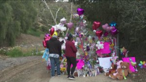 Family members gather on March 10, 2019, at the scene where a little girl was found dead inside of a duffel bag in Hacienda Heights on March 5, 2019. (Credit: KTLA)