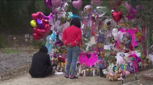 Family members of Trinity Love Jones pay their respects at the memorial near where her body was found in Hacienda Heights. (Credit: KTLA)