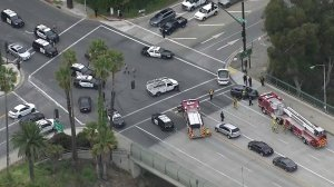 Police and CHP swarm the scene at the end of a pursuit in Pasadena on April 4, 2019. (Credit: KTLA)
