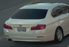 The BMW used by a pair of homicide suspects sought in an Amber Alert is seen in a surveillance image released by the Los Angeles County Sheriff's Department.