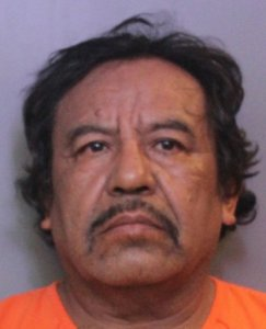 Carlos Carrizales is seen in a booking photo provided by the Polk County Sheriff's Office.
