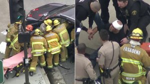 At right, firefighters work to extricate a woman after a pursuit driver crashed into her SUV in Pasadena on April 4, 2019. At left, authorities speak with the suspect following the crash. (Credit: KTLA)